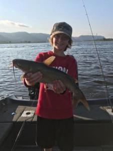 10 year old catching catfish near Wabasha MN